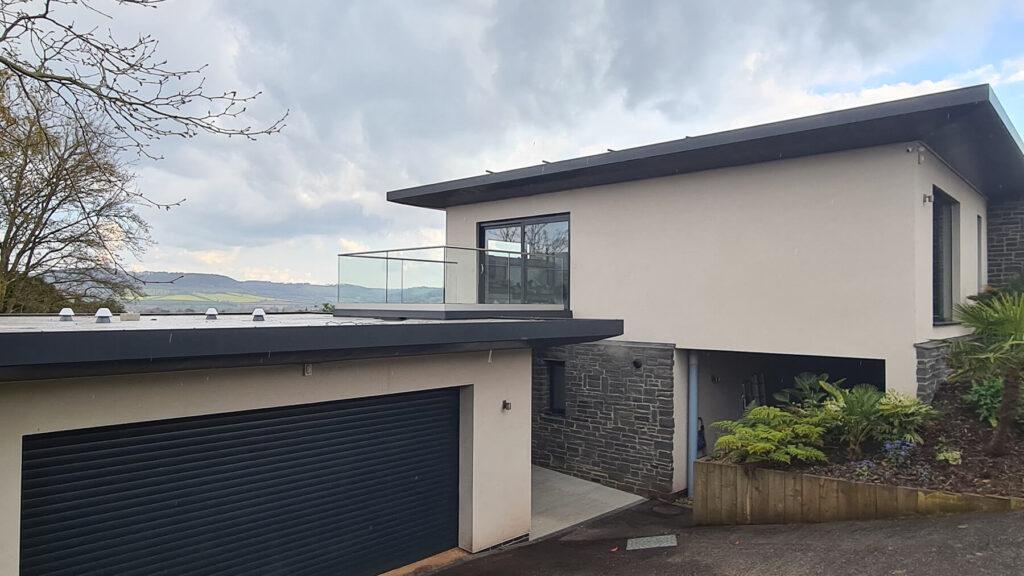 QBuild External Glass & Steel Balustrade Balcony & patio above garage build in Exeter