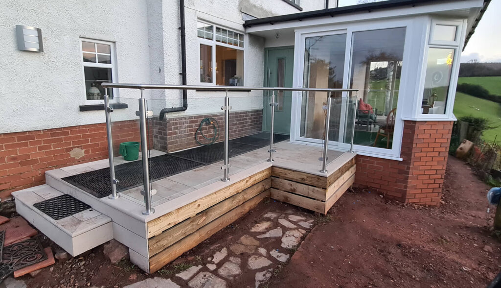 QBuild External entrance Glass & Steel Balustrade wirth deck build in Exeter