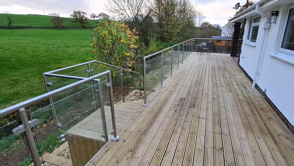 QBuild External raised decking with Glass & Steel Balustrade build in Exeter, Devon