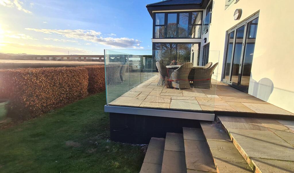 QBuild Glass Balustrade & stone patio build at the Exe Estuary in Exeter, Devon