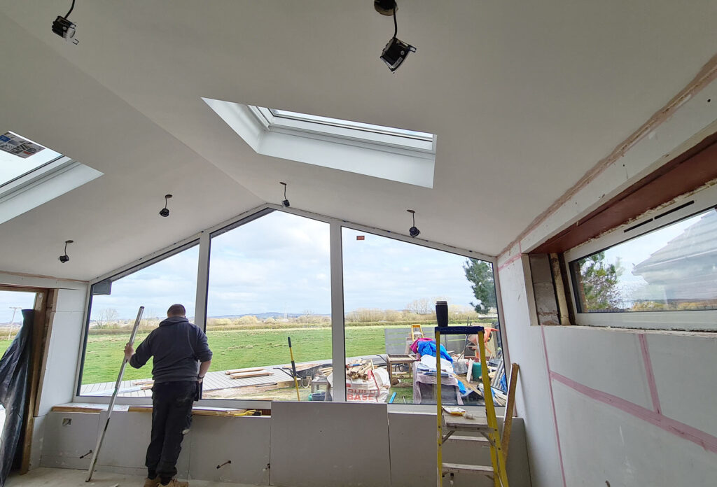 QBuild internal extension finishing with plastering in Exeter